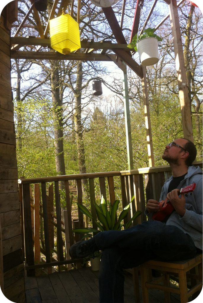 Playing music on the treehouse deck